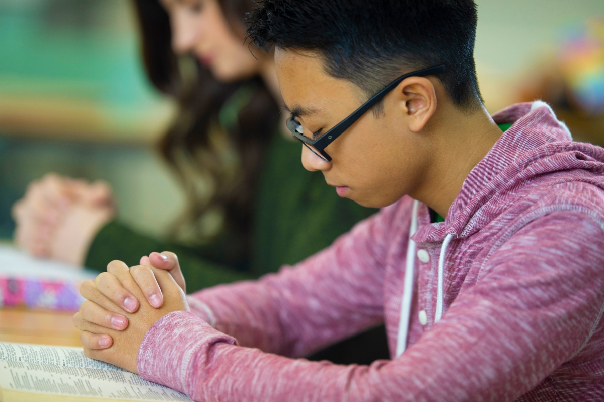 Students praying in class